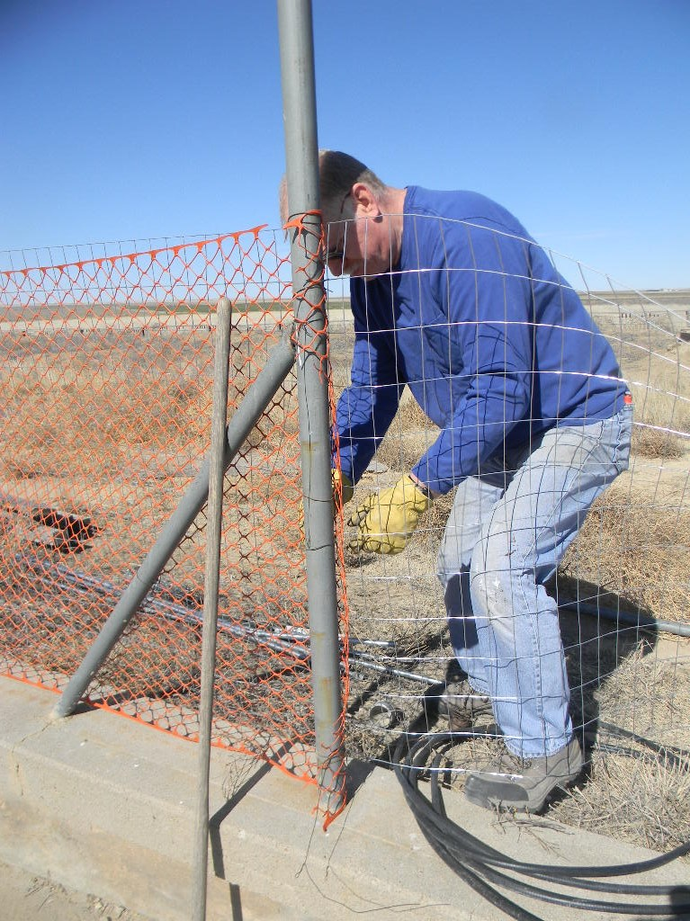 David Molter completing the last section of fence.